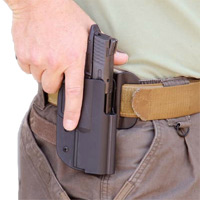 Good training and the right holster and belt make it easy to draw and reholster a handgun.